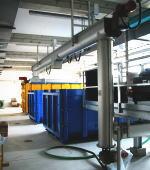 下水処理場での脱水汚泥搬送用スパイラルコンベア